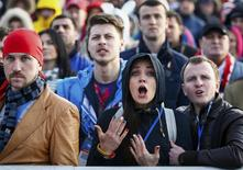 Russian fans react as they watch a broadcast of the ice hockey quarter-final match between Russia and Finland in the Olympic Park during the 2014 Winter Olympic Games in Sochi February 19, 2014. REUTERS/Shamil Zhumatov