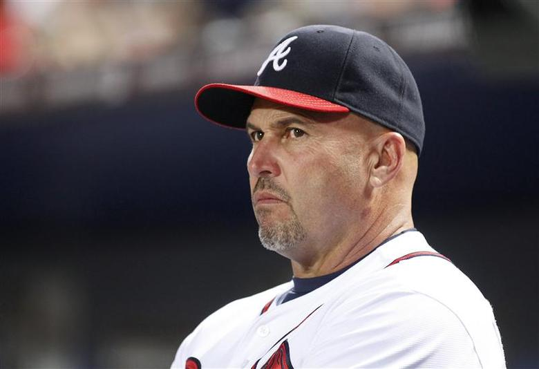 Atlanta Braves manager Fredi Gonzalez watches from the dugout in the fourth inning during play against the Milwaukee Brewers at their MLB National League baseball game in Atlanta, Georgia September 24, 2013. REUTERS/Tami Chappell