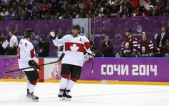 Canada's Shea Weber (R) celebrates his goal against Latvia with teammate Drew Doughty during the third period of their men's quarter-finals ice hockey game at the 2014 Sochi Winter Olympic Games, February 19, 2014. REUTERS/Gary Hershorn