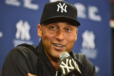 Feb 19, 2014; Tampa, FL, USA; New York Yankees infielder Derek Jeter (2) speaks to the media during an media availability at George M. Steinbrenner Field. Mandatory Credit: Tommy Gilligan-USA TODAY Sports - RTX194TU