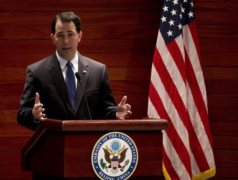 Wisconsin Governor Scott Walker speaks after witnessing a signing memorandum of understanding of the commercial deals between U.S. and China at the U.S. Embassy in Beijing Monday, April 15, 2013 file photo. REUTERS/Andy Wong/Pool