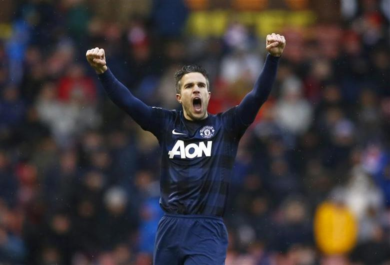 Manchester United's Robin Van Persie celebrates after scoring a goal against Stoke City during their English Premier League soccer match at the Britannia Stadium in Stoke-on-Trent, central England, February 1, 2014. REUTERS/Darren Staples