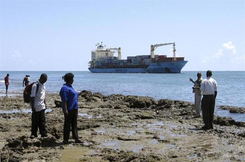 People look at the U.S. flagged container ship, Maersk Alabama as it sails into the Kenyan coastal sea port of Mombasa, November 22, 2009. REUTERS/Joseph Okanga/Files