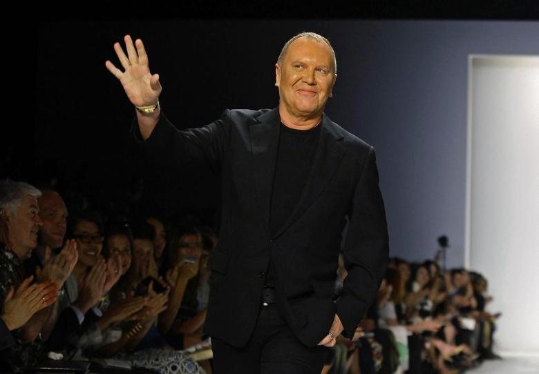 Designer Michael Kors acknowledges the crowd after his Spring/Summer 2014 collection show during New York Fashion Week in this file photo taken September 11, 2013. REUTERS/Joshua Lott/Files