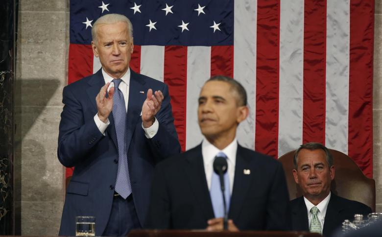 Vice President Joe Biden applauds and Speaker of the House John Boehner looks on as President Barack Obama delivers his State of the Union speech on Capitol Hill in Washington, January 28, 2014 file photo. REUTERS/Larry Downing