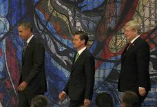 U.S. President Barack Obama (L) arrives with Mexico's President Enrique Pena Nieto (C) and Canada's Prime Minister Stephen Harper to attend a news conference at the North American Leaders' Summit in Toluca near Mexico City, February 19, 2014. REUTERS/Henry Romero