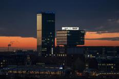 General view of buildings with advertising signs of the German insurer Allianz and the chemical company BASF during sunset in Berlin, November 22, 2013. REUTERS/Thomas Peter