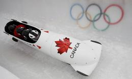 Canada's pilot Justin Kripps (front) and his teammates speed down the track during a four-man bobsleigh training session at the Sanki Sliding Center in Rosa Khutor, during the Sochi 2014 Winter Olympics February 19, 2014. REUTERS/Arnd Wiegmann