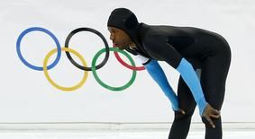 Shani Davis of the U.S. reacts after competing in the men's 1,500 metres speed skating race during the 2014 Sochi Winter Olympics, February 15, 2014. REUTERS/Marko Djurica