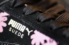 The logo of German sports goods firm Puma is seen on a shoe after the company's annual news conference in Herzogenaurach February 20, 2014. REUTERS/Michaela Rehle