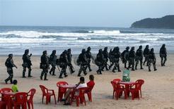 Riot police patrol the Santinho beach next the Costao do Santinho hotel ahead of the 2014 FIFA World Cup in Florianopolis, Santa Catarina state, February 19, 2014. REUTERS/Sergio Moraes