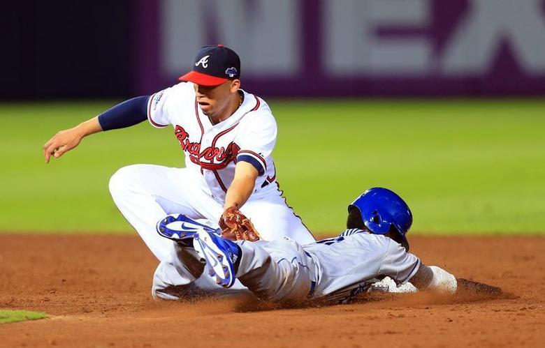 Oct 4, 2013; Atlanta, GA, USA; Atlanta Braves shortstop Andrelton Simmons (19) tags out Los Angeles Dodgers shortstop Dee Gordon (9) on a stolen base attempt in the ninth inning of game two of the National League divisional series playoff baseball game at Turner Field. Mandatory Credit: Daniel Shirey-USA TODAY Sports - RTR3FM0E