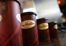 A row of Tim Hortons coffee cups are lined up for customers at Penn Station in New York, July 13, 2009. REUTERS/Brendan McDermid