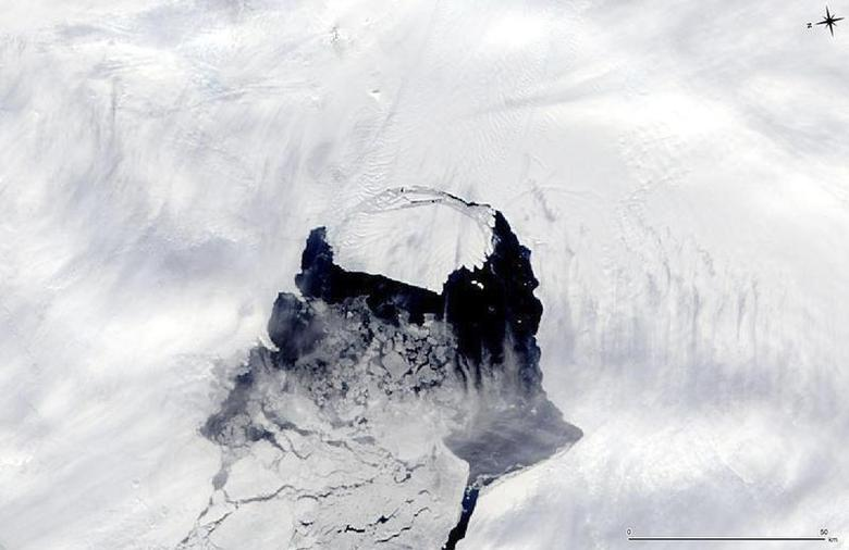 An iceberg which was part of the Pine Island Glacier is shown separating from the Antarctica continent in this MODIS image taken by NASA's Aqua satellite on November 10, 2013 and released by NASA November 14, 2013. REUTERS/NASA/Handout via Reuters