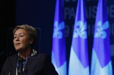 Quebec Premier Pauline Marois looks on during her closing speech at the Parti Quebecois Convention in Montreal, November 10, 2013 file photo. REUTERS/Christinne Muschi