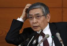 Bank of Japan Governor Haruhiko Kuroda scratches his head as he listens to questions from a reporter during a news conference at the BOJ headquarters in Tokyo February 18, 2014. REUTERS/Yuya Shino