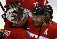Canada's Shea Weber (R) celebrates with goalie Carey Price after Canada won their men's ice hockey semi-final game against Team USA at the 2014 Sochi Winter Olympic Games, February 21, 2014. REUTERS/Grigory Dukor