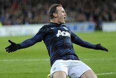 Manchester United's Wayne Rooney celebrates scoring a goal against Cardiff City during their English Premier League soccer match at Cardiff City Stadium in Cardiff, Wales, November 24, 2013. REUTERS/Rebecca Naden
