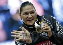 Winner Valerie Adams of New Zealand shows her gold medal at the victory ceremony for the women's shot put final during the IAAF World Athletics Championships at the Luzhniki stadium in Moscow August 12, 2013. REUTERS/Grigory Dukor