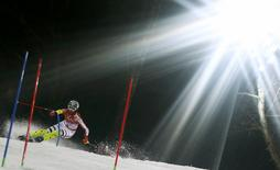 Germany's Maria Hoefl-Riesch clears a gate during the second run of the women's alpine skiing slalom event at the 2014 Sochi Winter Olympics at the Rosa Khutor Alpine Center February 21, 2014. REUTERS/Dominic Ebenbichler
