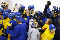 Sweden men's ice team gathers for a cheer at the end of a practice session at the 2014 Sochi Winter Olympics February 22, 2014, ahead of their gold medal game against Canada on February 23. REUTERS/Brian Snyder