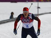 Russia's Alexander Legkov approaches the finish line to win the men's cross-country 50 km mass start free event at the Sochi 2014 Winter Olympic Games in Rosa Khutor February 23, 2014. REUTERS/Carlos Barria