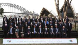 Central Bank Governors and Finance Ministers of G20 countries pose for a family picture near the Sydney Opera House and Sydney Harbour Bridge, February 22, 2014. REUTERS/Rob Griffith/Pool