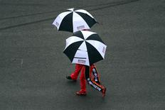 Feb 23, 2014; Daytona Beach, FL, USA; NASCAR Sprint Cup Series driver Jamie McMurray (1) walks under an umbrella during a rain delay during the Daytona 500 at Daytona International Speedway. Andrew Weber-USA TODAY Sports