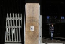 A man leaves the Bank of Greece headquarters in central Athens November 27, 2013. REUTERS/John Kolesidis