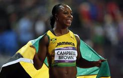 Jamaica's Veronica Campbell-Brown celebrates after finishing third the women's 100m final during the London 2012 Olympic Games at the Olympic Stadium August 4, 2012. REUTERS/Mark Blinch
