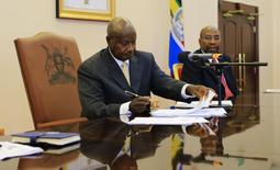 Uganda President Yoweri Museveni signs an anti-homosexual bill into law at the state house in Entebbe, 36 km (22 miles) south west of capital Kampala February 24, 2014. REUTERS/James Akena