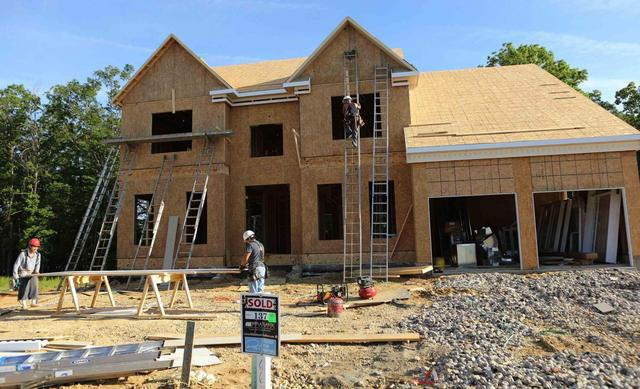 Carpenter's work on a housing site at Mid-Atlantic Builders ''The Villages of Savannah'' development in Brandywine, Maryland May 31, 2013. REUTERS/Gary Cameron