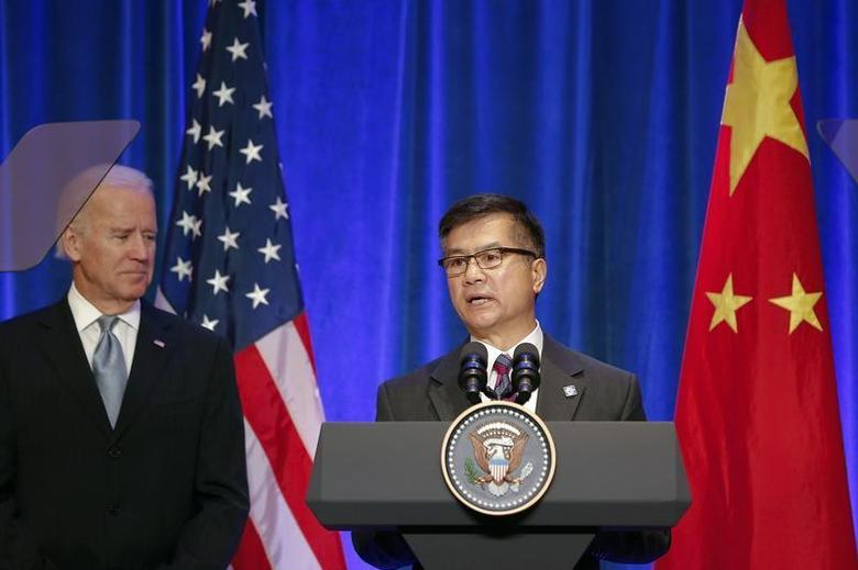U.S. ambassador to China Gary Locke gives a speech next to U.S Vice President Joe Biden (L) during a joint business leader breakfast event at The St. Regis Beijing hotel in Beijing December 5, 2013. REUTERS/Lintao Zhang/Pool