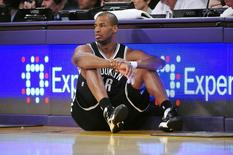 February 23, 2014; Los Angeles, CA, USA; Brooklyn Nets center Jason Collins (46) waits to enter the game against the Los Angeles Lakers during the second half at Staples Center. Mandatory Credit: Gary A. Vasquez-USA TODAY Sports - RTX19E4K