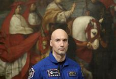 Italian astronaut Luca Parmitano attends a meeting with Prime Minister Enrico Letta (unseen) at Chigi palace in Rome, December 11, 2013. REUTERS/Remo Casilli