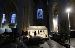 A tent is illuminated as Afghan asylum seekers camp inside the Church of Saint John the Baptist at the Beguinage in central Brussels February 6, 2014. REUTERS/Francois Lenoir