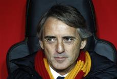 Galatasaray's coach Roberto Mancini reacts before the start of his team's Champions League soccer match against Chelsea at Turk Telekom Arena in Istanbul February 26, 2014. REUTERS/Osman Orsal