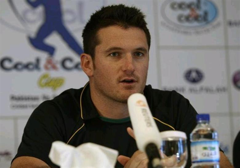 South Africa's captain Graeme Smith speaks during a news conference in Abu Dhabi on October 26, 2010. REUTERS/Nikhil Monteiro/Files