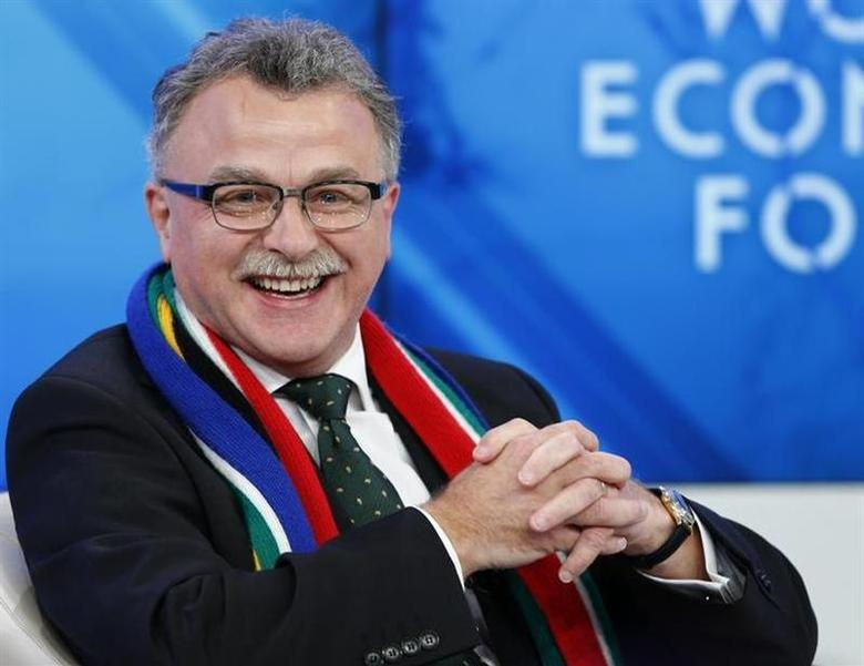 Julian Roberts, Group Chief Executive of Old Mutual smiles during a session at the annual meeting of the World Economic Forum (WEF) in Davos January 22, 2014. REUTERS/Denis Balibouse