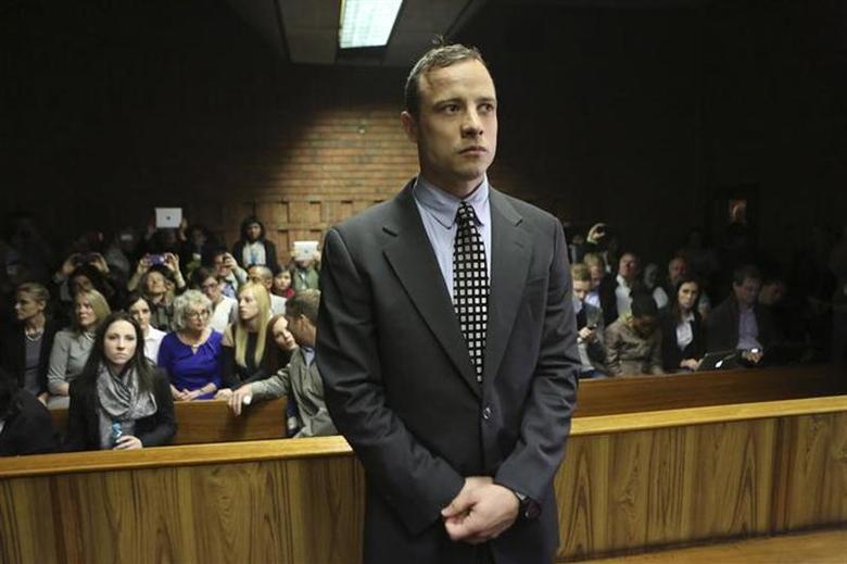 Oscar Pistorius enters the dock before court proceedings at the Pretoria Magistrates court June 4, 2013. REUTERS/Siphiwe Sibeko/Files