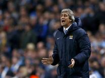 Manchester City's manager Manuel Pellegrini reacts during their Champions League round of 16 first leg soccer match against Barcelona at the Etihad Stadium in Manchester, northern England February 18, 2014. REUTERS/Darren Staples
