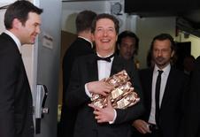 """French actor Guillaume Gallienne (C) holds his trophy during a photocall after receiving the Best Actor, Best first Film, Best adaptated Screenplay and best film awards in the film """"Les garcons et Guillaume, a table!"""" (Me, Myself and Mum) at the 39th Cesar Awards ceremony in Paris February 28, 2014. REUTERS/Regis Duvignau"""