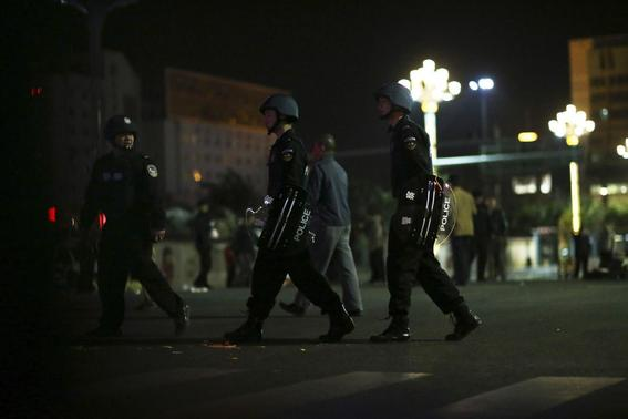 Police patrol on a street after a group of armed men attacked people at Kunming railway station, Yunnan province, March 1, 2014. REUTERS-Wong Campion