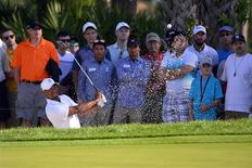 Mar 1, 2014; Palm Beach Gardens, FL, USA; Tiger Woods chips out of a bunker to the 8th green during the third round of The Honda Classic golf tournament at PGA National GC Champion Course. Bob Donnan-USA TODAY Sports