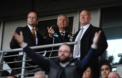 Newcastle United's manager Alan Pardew (top centre) watches from the stand after being sent off during their English Premier League soccer match against Hull City at the KC Stadium in Hull, northern England March 1, 2014. REUTERS/Nigel Roddis