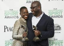 "Actress Lupita Nyong'o and director Steve McQueen pose with their awards for ""12 Years a Slave"" backstage at the 2014 Film Independent Spirit Awards in Santa Monica, California March 1, 2014. REUTERS/Danny Moloshok"
