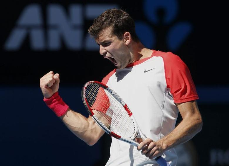 Grigor Dimitrov of Bulgaria reacts during his men's singles quarter-final tennis match against Rafael Nadal of Spain at the Australian Open 2014 tennis tournament in Melbourne January 22, 2014. REUTERS/Bobby Yip