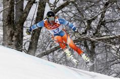 Norway's Kjetil Jansrud skis during the first run of the men's alpine skiing giant slalom event at the 2014 Sochi Winter Olympics at the Rosa Khutor Alpine Center February 19, 2014. REUTERS/Stefano Rellandini