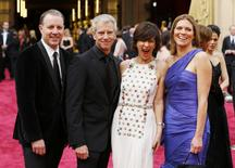 """Chris Sanders (2nd L), Kirk DeMicco (L), Kristine Belson (2nd R), and Jane Hartwell, nominees for best animated feature for their film """"The Croods"""" arrive at the 86th Academy Awards in Hollywood, California March 2, 2014. REUTERS/Mike Blake"""