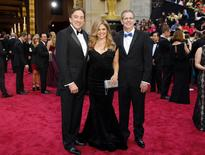 "Producers Chris Buck (L), Jennifer Lee (C) and Peter Del Vecho, best animated feature film nominees for ""frozen"" arrive at the 86th Academy Awards in Hollywood, California March 2, 2014. REUTERS/Mike Blake"